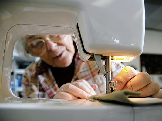 Robin Zielinski   Sun-NewsMoonbow Alterations and Custom owner Alice Davenport uses a sewing machine on Wednesday at the store that was formerly located on Alameda Boulevard and just finished moving to its new location at 225 E. Idaho Ave.