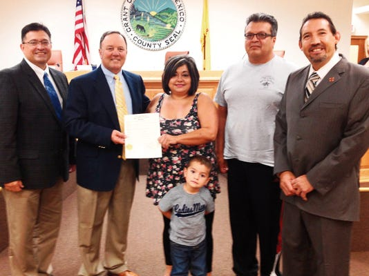 "The Grant County Board of County Commissioners proclaimed Sept. 26 ""Walk For Heroes Appreciation Day."" On hand for the proclamation on Thursday were Commissioner Gabriel Ramos, from left, Commission Chairman Brett Kasten, event organizers Liz Lopez and Mike Lopez, son Josh Valencia, and County Assessor Raul Turrieta. Randal Seyler - Sun-News"