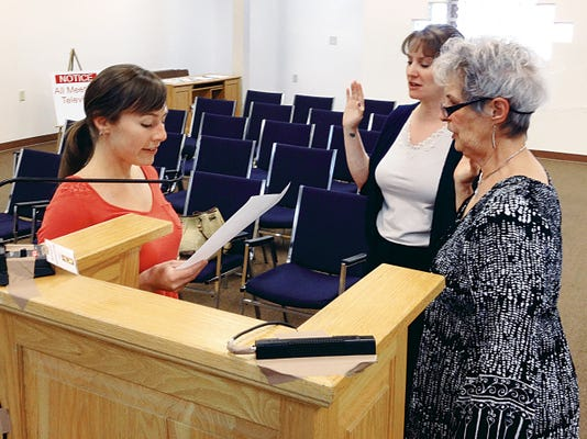 Traci Burnsed, left, city planning technician, swears in Jaime Embick, planner/zoning administrator and artist Ann Alexander during Tuesday's Silver City Planning & Zoning Commission meeting. Randal Seyler - Sun-News