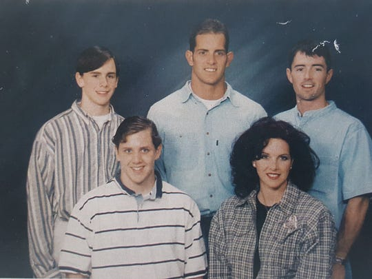 Rusty Larabell (top left) poses with his siblings in this photo taken in the mid-1990s. Larabell was a sophomore at Naples High School when he died from a brain aneurysm after a junior varsity game in October 1998. From L to R: Rusty Larabell, brother Josh Larabell, half-brother Ben Welzbacher, half-sister Polly Welzbacher, half-brother Bob Welzbacher.