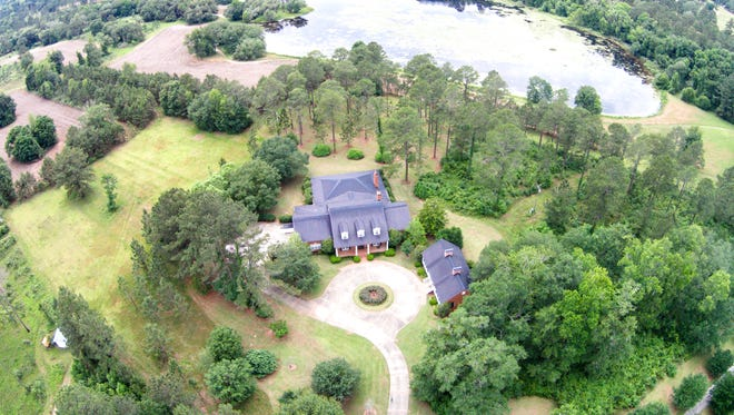 The 7,000-square-foot brick main house overlooks the 30-acre Cody Lake and features expansive living areas and deep southern porches on all sides of the house.