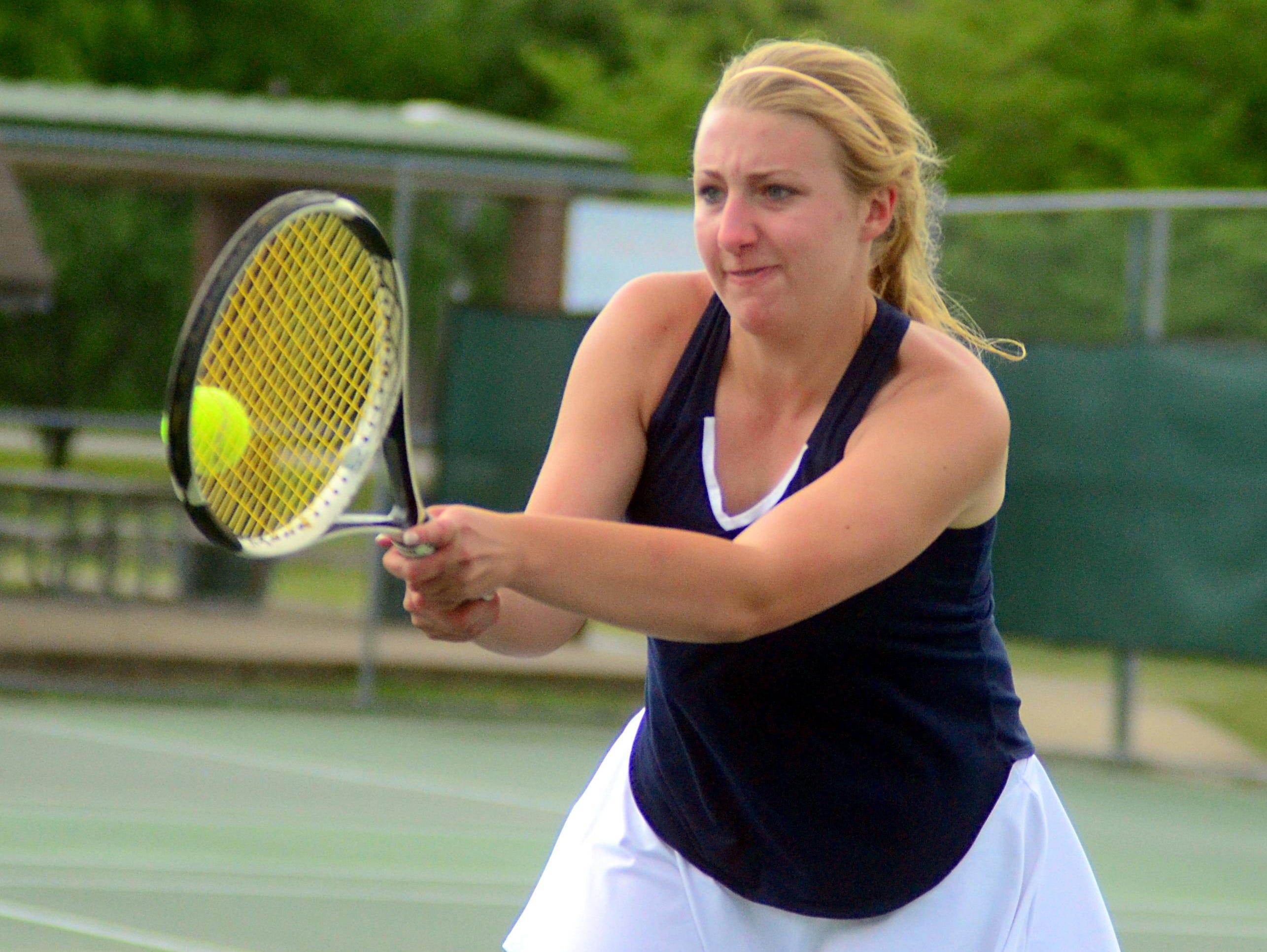 Beech High senior Allie Guinn volleys at the net during Wednesday's doubles semifinals.
