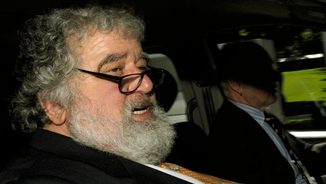 In this May 29, 2011 file photo FIFA official Chuck Blazer leaves the FIFA headquarters in Zurich, Switzerland.