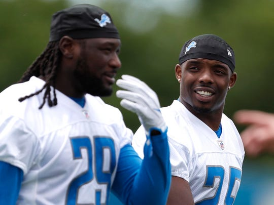 Detroit Lions running back Theo Riddick (right) and running back LeGarrette Blount (29) walk off the field after practice at the Lions Headquarters and Training Facility on Tuesday, June 5, 2018.