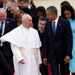 Pope Francis is met by President Barack Obama, accompanied by first lady Michelle Obama, after arriving Tuesday at Andrews Air Force Base in Maryland.