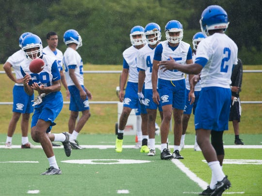 The University of West Florida receiving corps hones their ball handling skills during a soggy start to the team's 2016 football season Thursday morning.