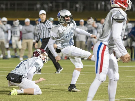 Place kicker Colton Norris (8) watches as his game winning field goal sails through the uprights in overtime during the All-Star Football Game at Blue Wahoos Stadium in Pensacola on December 16, 2016.