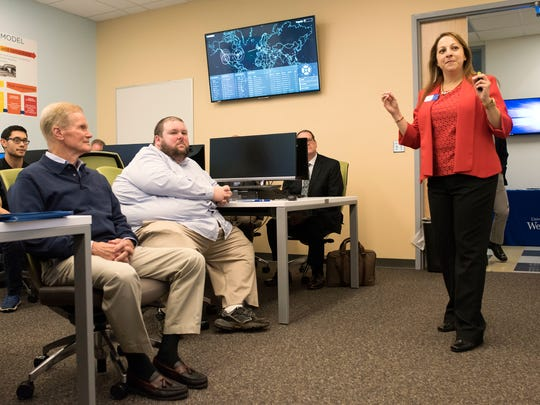 Eman El-Sheikh, director of the University of West Florida's Center for Cybersecurity, describes the university's cybersecurity curriculum to Sen. Bill Nelson, left, during his visit to the school on Friday, May 5, 2017.