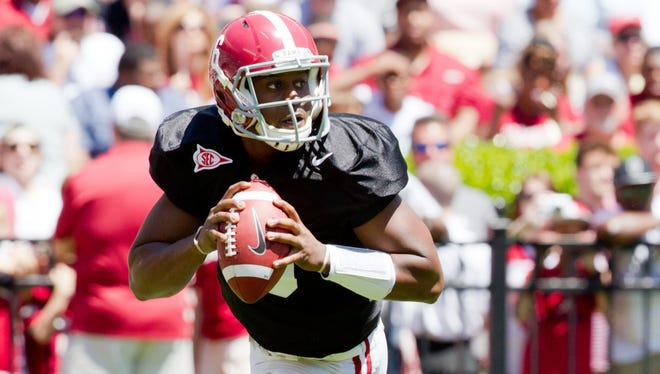 Quarterback Blake Sims says a focusing on what it takes to win a national championship is more important than focusing on a quarterback competition.