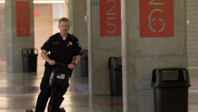 An ASU officer at University of Phoenix Stadium uses a Segway, which officers used during the 2008 Super Bowl in Glendale.