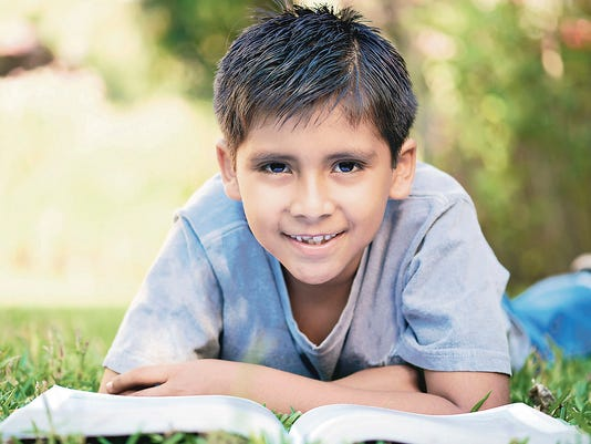 small boy with big book