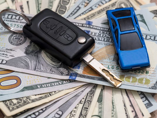 car key with pen and dollar