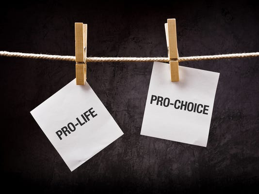 Pro-life vs pro-choice, abortion concept