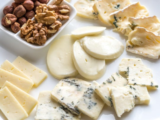 Various types of cheese with nuts.