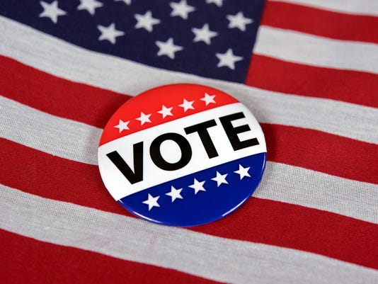 voting pin on American flag
