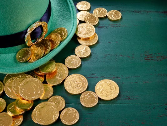 Happy St Patricks Day leprechaun hat with gold chocolate coins