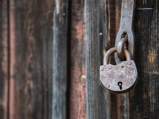 The old door locked with a padlock hanging brackets. Set of backgrounds