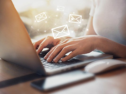 Woman using Laptop with email icon