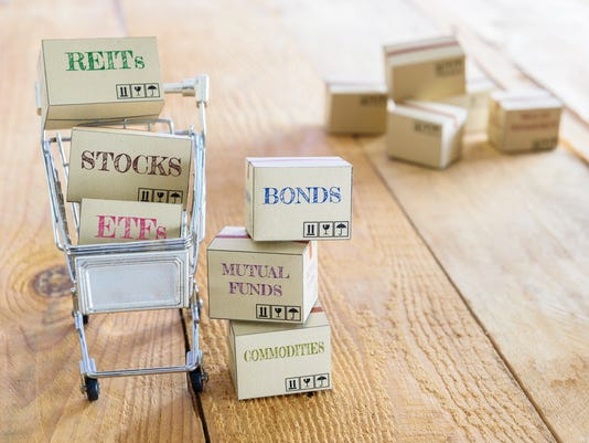 Cartons of financial investment products in a shopping cart.