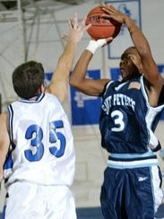 Keydren Clark (right) shoots against Monmouth in 2002.