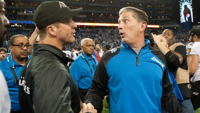Ravens coach John Harbaugh, left, and Lions coach Jim Schwartz shake hands after Monday's game at Ford Field.