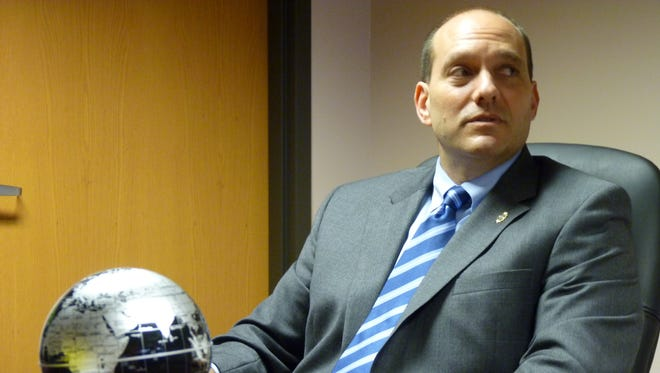 A local newspaper editor has filed ethics complaints against Middlesex County Prosecutor Andrew Carey (pictured) and other county officials alleging that they did not properly file their financial disclosure forms.