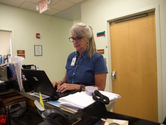 Carol Ewing, a certified nurse midwife works on her computer, Monday, July 11, 2017 at San Juan Health Partners Family Medicine Clinic in Aztec.
