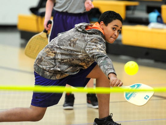 Seventh grader Gavin Clifton chases down a ball while