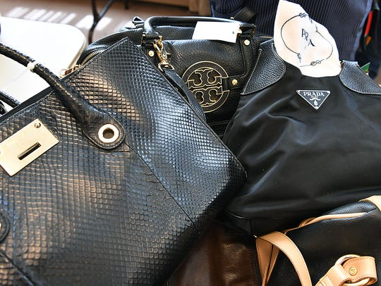 In this 2018 file photo, thousands of designer bags, shoes, coats, clothes and jewelry are included in the first Faith Fashion Boutique event to raise money for the Faith Refuge for Women.