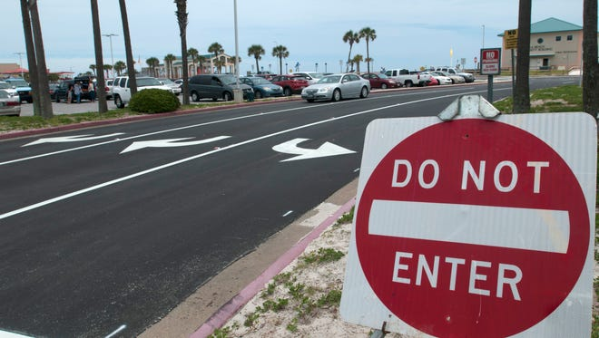 Vehicles exit the Casino Beach Parking lot on Fort Pickens Road Monday afternoon May 22, 2017. The new one-way traffic pattern offers an entrance on Via Deluna and exit on Fort Pickens Road.