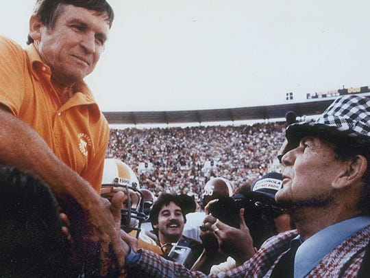 UT coach Johnny Majors accepts the congratulations of Alabama coach Bear Bryant after a Vols victory in 1982.