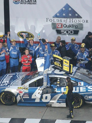 Jimmie Johnson celebrates after winning the Folds of