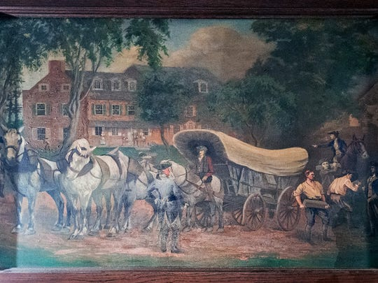 It is speculated that the York colonial history stained glass windows were once installed in the original director's room of the main bank building. This painting also done by Rudy is permanently York hung over the fireplace.  Paul Kuehnel - York Daily Record/ Sunday News