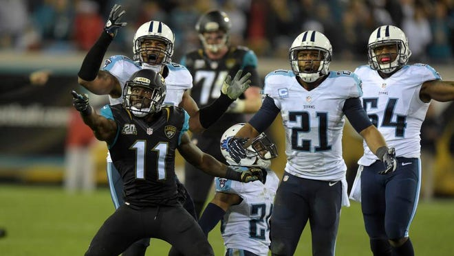 Titans players and Jaguars wide receiver Marqise Lee react to a pass interference call against Titans cornerback Coty Sensabaugh (kneeling) late in the fourth quarter.