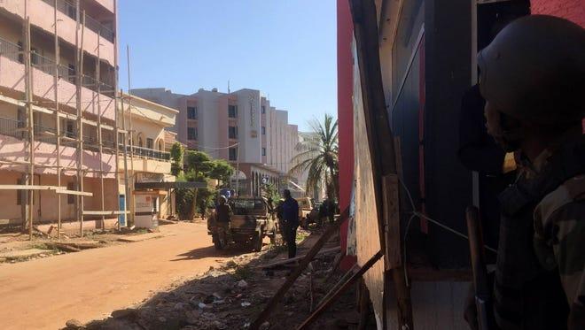 Malian troops take position outside the Radisson Blu hotel in Bamako on Nov. 20.
