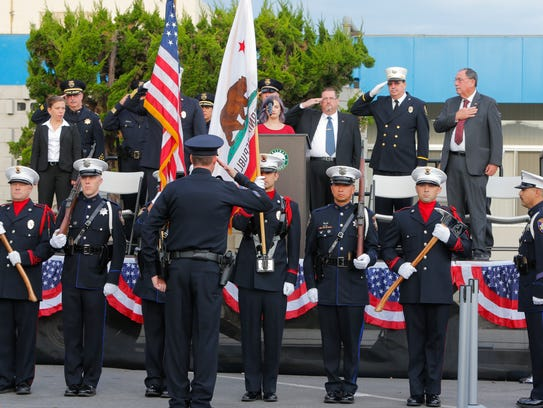 Members of the Salinas police and fire color guard