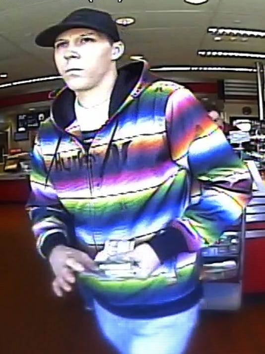 Convenience store robbery suspect 1