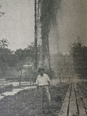 Blowing In with gas and salt water is Breece No. C-1 gas well in the producing area below the Monroe Municipal Airport in 1950. Duncan S. Cook, who served as Monroe District Manager of the Louisiana Department of Conservation, stands in the foreground on the day the well began producing, Sept. 3, 1950. This well was one of several drilled during that period in the Millhaven Field. The well was brought in by Petersen Drilling Co. in Section 17 of 17-5E, an area southeast of the original Monroe Gas Field.