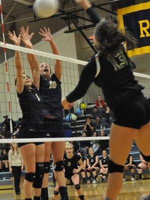 Ruidoso volleyball players Alexa Herrera and Lia Mosher block a hit by Hope Christian's Lauren Trejo Oct. 25 in Ruidoso.