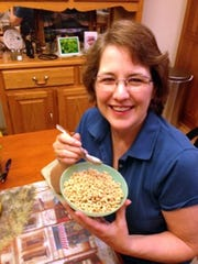 Noreen O'Brien of Fond du Lac eats Cheerios with the Mary Poppins spoon her mother sent away for by saving cereal box tops.