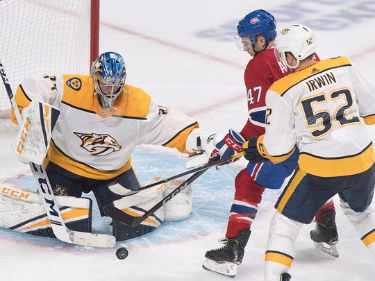 Montreal Canadiens' Kenny Agostino (47) moves in against Nashville Predators goaltender Juuse Saros as Predators' Matt Irwin defends during third-period action in Montreal on Saturday.