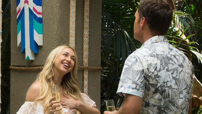 Corinne Olympios arrives on 'Bachelor in Paradise' and is greeted by host Chris Harrison.