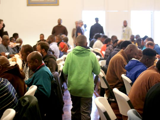 Volunteers deliver meals at the annual Thanksgiving Banquet at Memphis Union Mission.