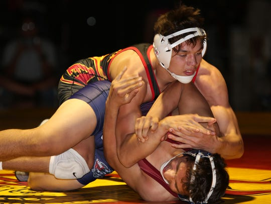 FILE - Palm Desert's Anthony Mantanona, top, wrestles