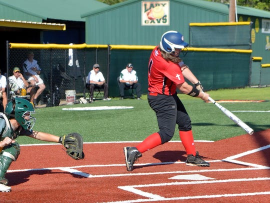 Evangel's Taylor Mayo turns on a pitch from Calvary's