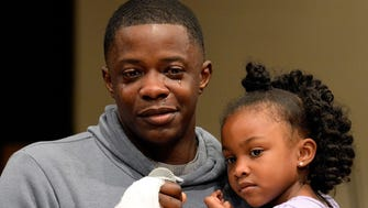 James Shaw Jr. holds his daughter Brooklyn Shaw, 4, while speaking during a prayer vigil at the Mount Zion Baptist Church on Monday, April 23, 2018, in Antioch, Tenn. Civic leaders and residents attended the vigil for those affected by the Sunday, April 22, 2018, shooting at Waffle House.