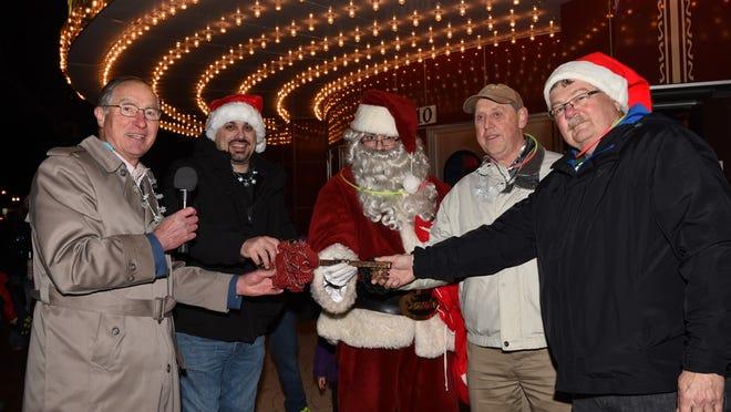 Wayne Mayor James Hawley (from left) and City Councilman John Rhaesa, Albert Damition and Skip Monit give Santa the key to the city of Wayne at the end of the parade.