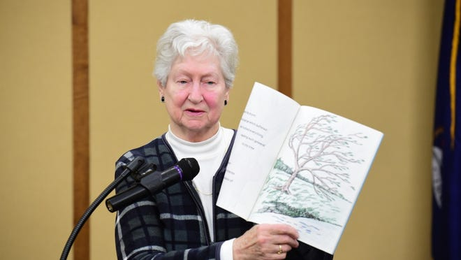 Ann Sokalski of Redford reads from her published book, 'My Tree,' that features artwork created by her daughter along with her poetry, at the Redford Library Wednesday night.