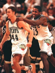 MSU's Jason Klein, left, and Antonio Smith, right,