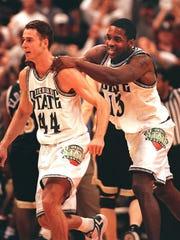 MSU's Jason Klein, left, and Antonio Smith, right,